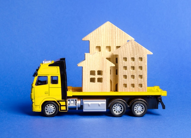 A cargo truck transports houses. concept of transportation and cargo shipping, moving company