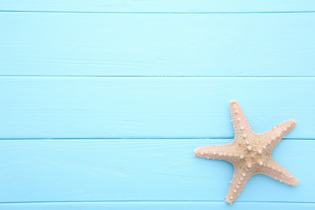 Caribbean starfish on blue wooden.top view