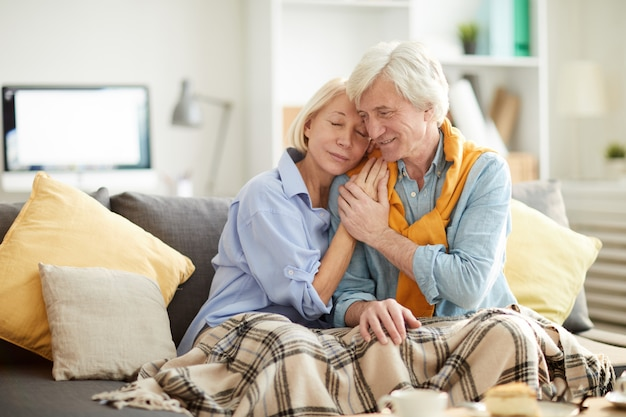 Caring senior couple embracing