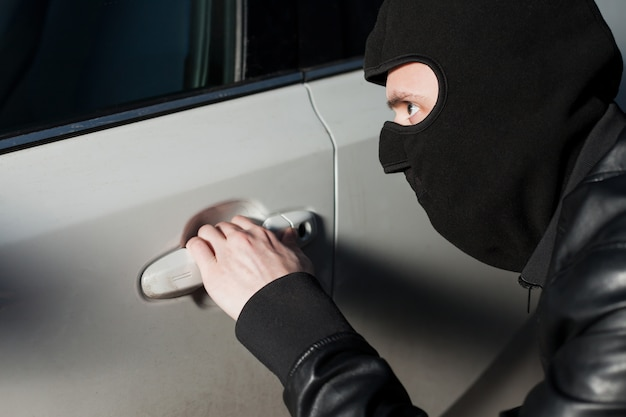 Carjacking danger, car insurance concept