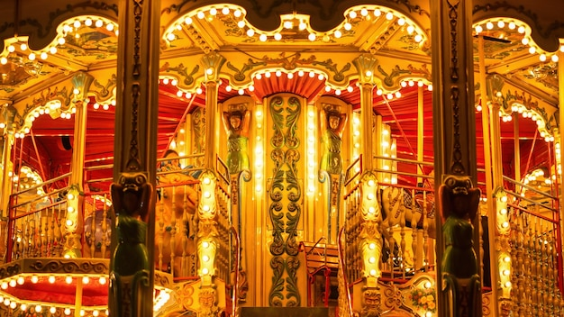 A carnival amusement ride at night with illumination, cannes, france