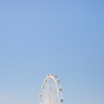 Carnival ferris wheel against clean sky