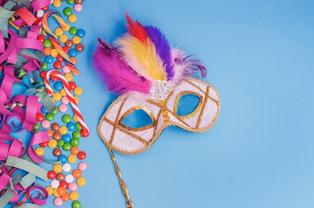 Carnival mask  on a blue background with mardi gras, brazilian, venetian carnival  with copy space