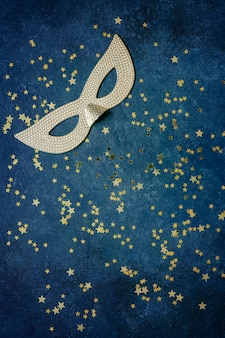 Carnival mask and gold glitter confetti