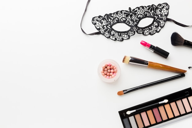 Carnival mask and make-up kit with copy space