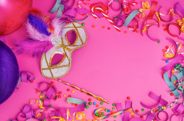 Carnival mask  on a pink background with mardi gras, brazilian, venetian carnival  with copy space