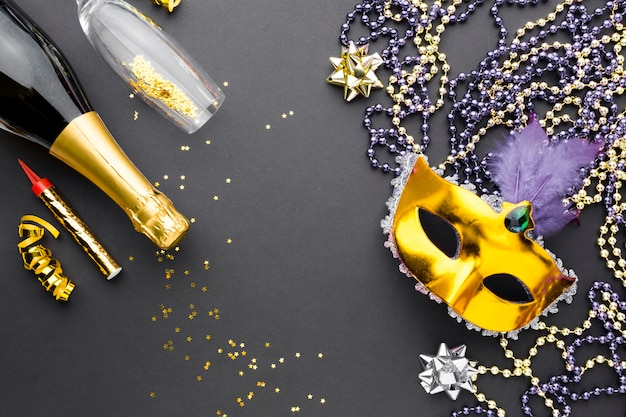 Carnival mask with champagne and jewelry
