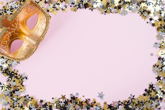Carnival mask with small spangles on pink table