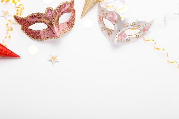 Carnival masks and confetti