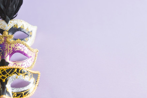 Carnival masks on lilac