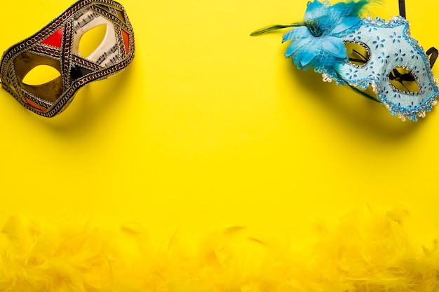 Carnival masks on yellow background