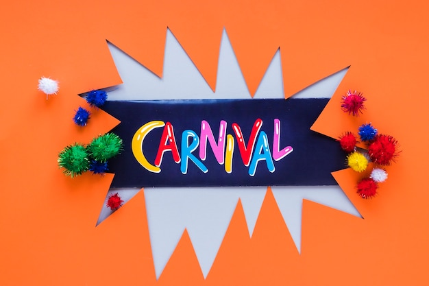 Carnival paper cut-out with colorful pom-poms