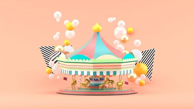 Карусель среди разноцветных шариков на розовом. 3d визуализация
