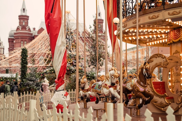 Carousel at the christmas fair in winter on red square in moscow