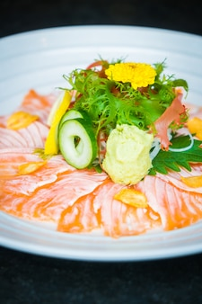 Carpaccio salmon in white plate