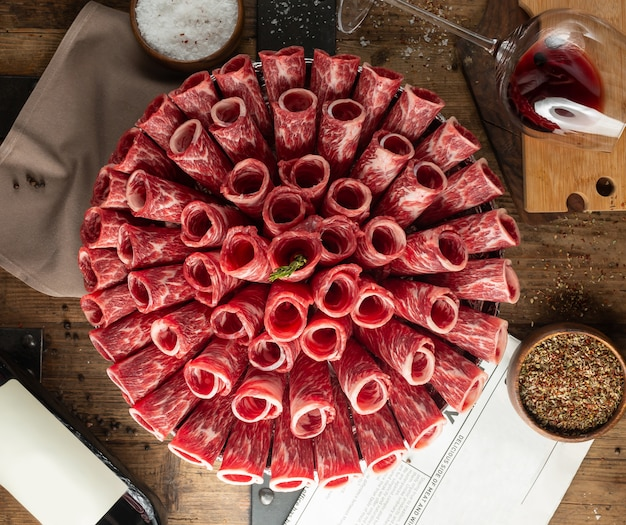 Carpaccio slices rolled in tubes in bouquet shape