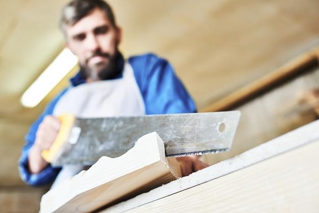 Carpenter hand cutting wood