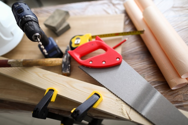 Carpenter hand tools and patterns lie on workbench