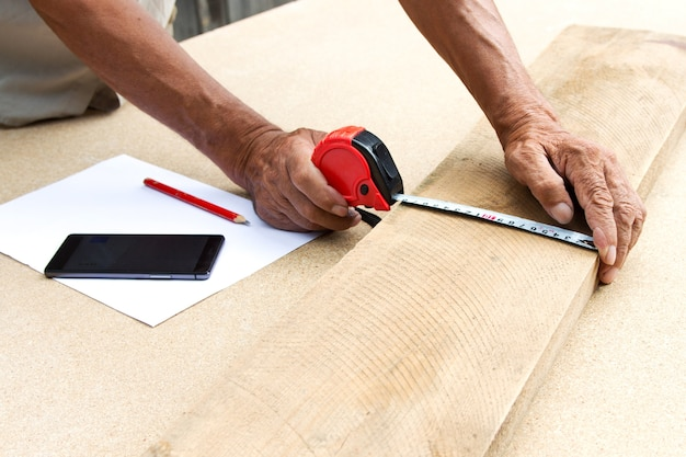 Carpenter inspect the quality of the material and calculate the required quantity for production