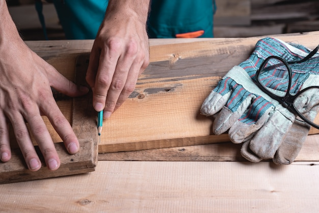 Carpenter, joiner at work in the workshop