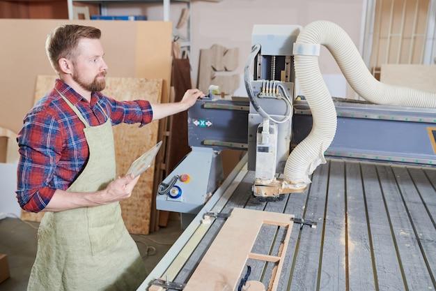 Carpenter at machine