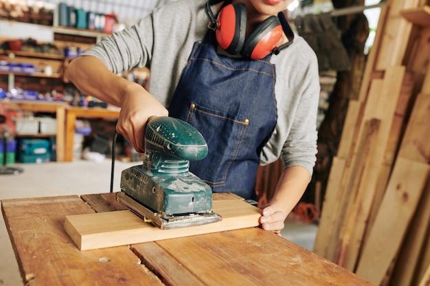 Carpenter polishing wood