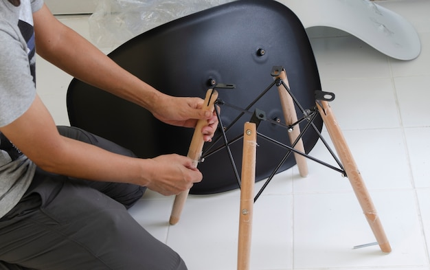 Carpenter putting together parts of chair