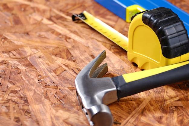 Carpenter tools on hardboard