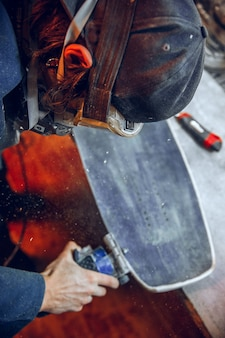 Carpenter using circular saw for cutting wooden boards. construction details of male worker or handy man with power tools
