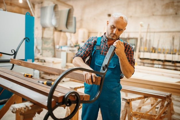 Carpenter, wooden bench manufacturing, woodworking, lumber industry, carpentry. , joiner job