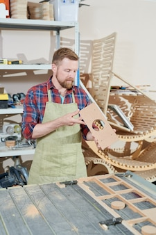 Carpenter working at carpentry shop
