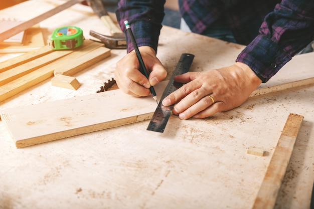 Carpenter working,hammer,tape measure and cutting pliers