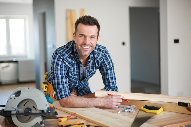 Carpenter working in a house