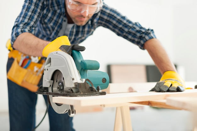 Carpenter working with circular saw