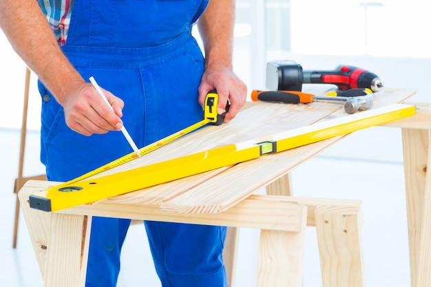 Carpenter working at workbench in office