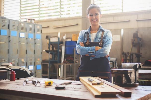 Carpenter on workplace in carpentry workshop.