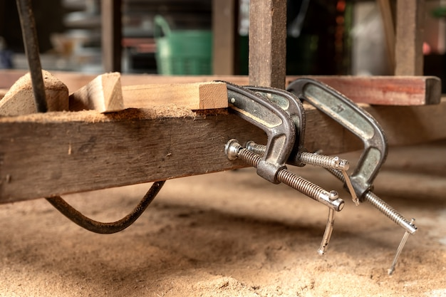 Carpenters use wood clamps on wood craft.