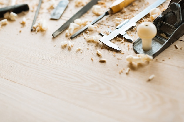 Carpentry tools on wooden table background