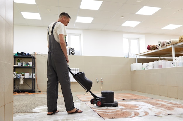 Carpet chemical cleaning with professionally disk machine early spring cleaning or regular clean up