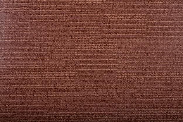 背景を覆うカーペット。茶色のカーペットの模様と質感。コピースペース