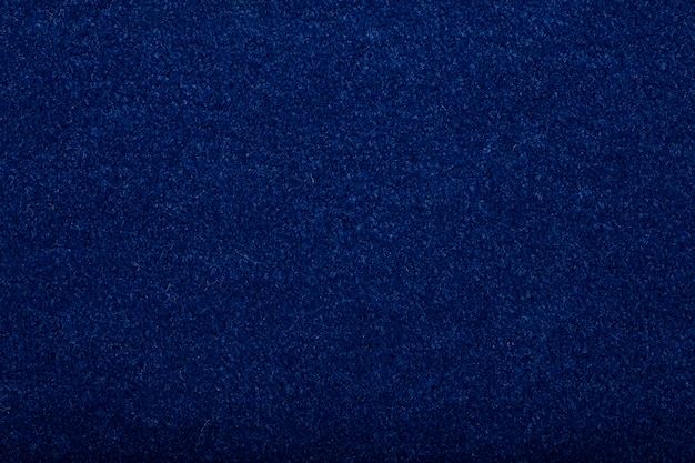 Carpet covering background. pattern and texture of blue colour carpet. copy space