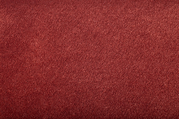 Carpet covering background. pattern and texture of burgundy colour carpet. copy space.