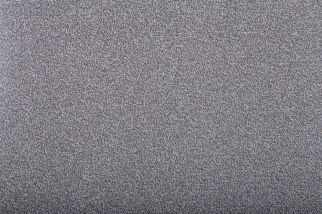 Carpet covering background. pattern and texture of gray colour carpet. copy space