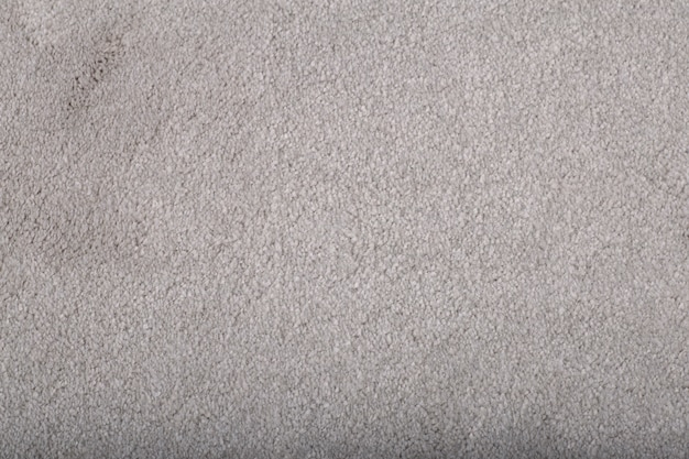 Carpet covering background. pattern and texture of grey colour carpet. copy space.