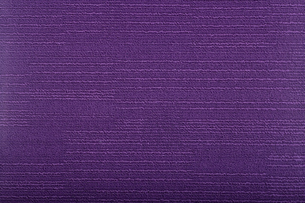 Carpet covering background. pattern and texture of purple colour carpet. copy space
