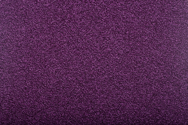 Carpet covering background. pattern and texture of violet colour carpet. copy space