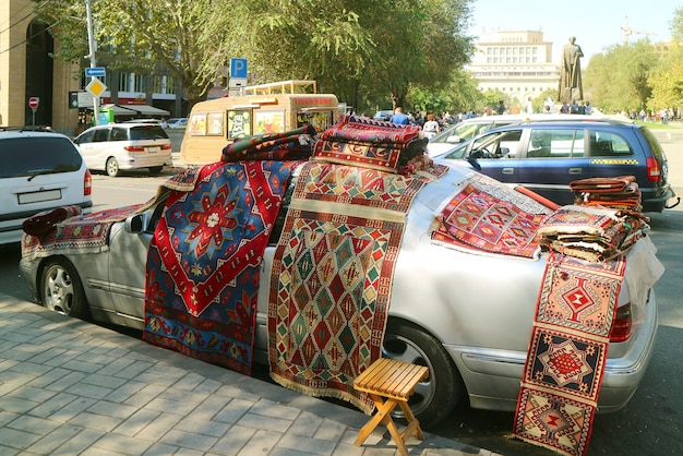 Carpets for sale displayed on the car at vernissage market in yerevan, the capital city of armenia