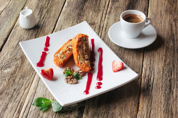 Carrot apple roll with espresso on table