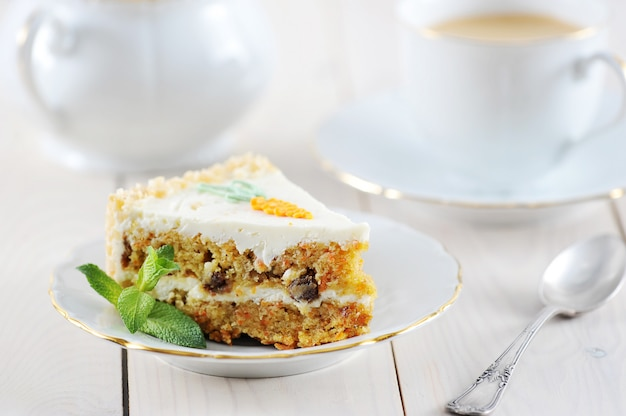 Carrot cake slice with mint and coffee