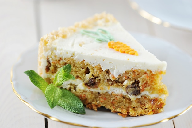Carrot cake slice with mint